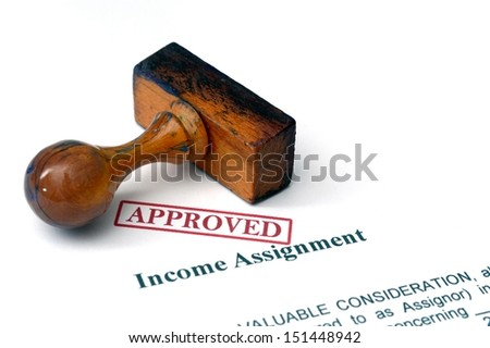 Income assignment - approved - stock photo