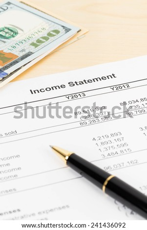 Income statement financial report with pen, and banknote
