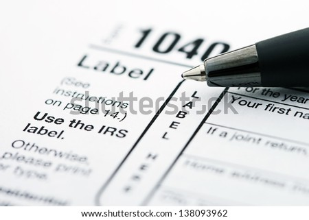 Income tax form and pen. Finance concept. - stock photo