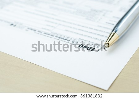 Income tax form with pen ,tax submission concept