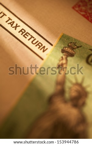 Income tax return check on tax return document. - stock photo