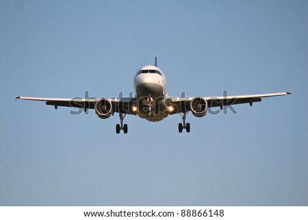 Incoming airplane - stock photo