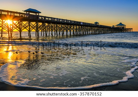 Incoming tide at Folly Beach Pier in Charleston SC - stock photo