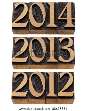 incoming years 2012, 2013, 2014 - isolated numbers in vintage wood printing blocks - stock photo