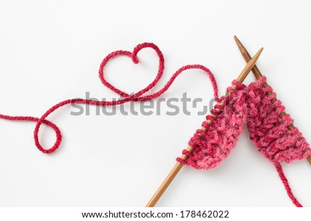Incomplete knitting project with wooden needles - stock photo