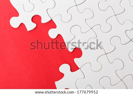 Incompleted white puzzle  - stock photo