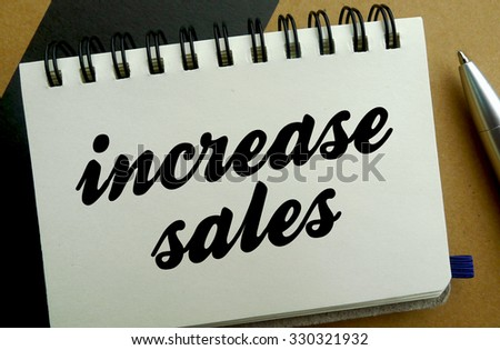 Increase sales memo written on a notebook with pen