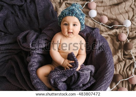 Incredible and charming newborn baby lying on soft blanket