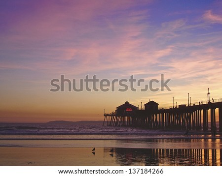 Incredible colors of the sunset by the Huntington Beach Pier, CA - stock photo