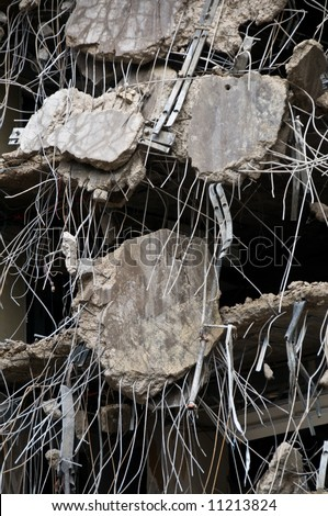 incredible detail of demolished concrete hanging from rebar - part of series - stock photo