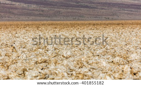 Incredibly serrated spires of salt. Salt has created complex structures. Wind and rain sculpt the salty spires into fascinating shapes. Devil's Golf Course, Death Valley National Park - stock photo