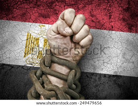 Independence: the hand, fist in chains and the flag of Egypt - stock photo