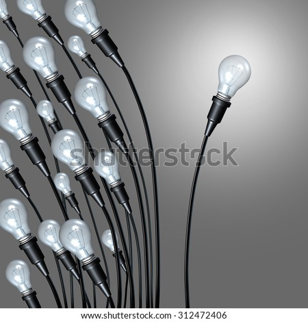 Independent idea business concept and new creative thinking and individual creativity symbol breaking away from a group as lightbulbs leaning on one side and an individual light setting a new path. - stock photo