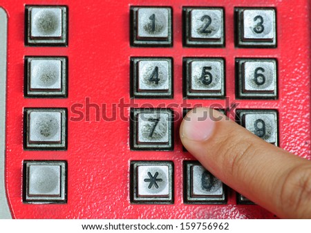 index finger dial the red public telephone button - stock photo