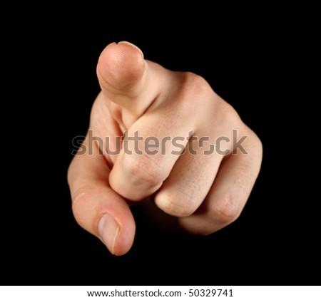Index finger on black background - stock photo