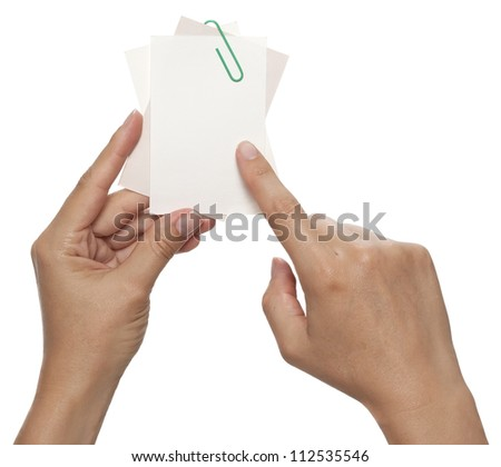 Index finger showing on blank annotation card - stock photo