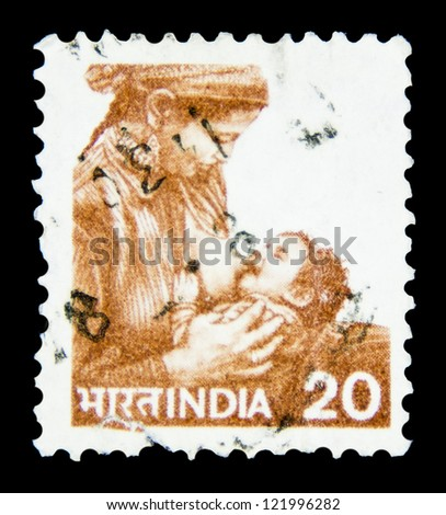 "INDIA - CIRCA 1979: A stamp printed in India shows a Mother feeding child, without inscription, from the series ""Mother and child"", circa 1979"