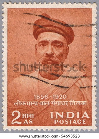 INDIA - CIRCA 1956: A stamp printed in India shows a portrait of the Indian independence leader Bal Gangadhar Tilak, circa 1956 - stock photo