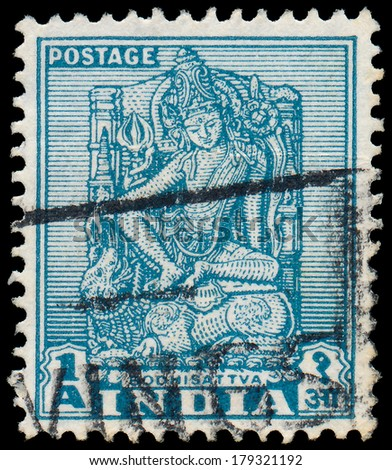 INDIA - CIRCA 1950: a stamp printed in India shows Bodhisattva, Sculpture of Bodhisattva, Enlightenment Being, circa 1950  - stock photo