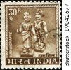 INDIA - CIRCA 1965: A stamp printed in India shows Indian dolls, circa 1965 - stock photo