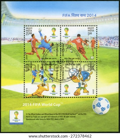 INDIA - CIRCA 2014: A stamp printed in India shows soccer players and Fuleco, dedicated the 2014 FIFA World Cup Brazil, June 12 -  July 13, circa 2014 - stock photo