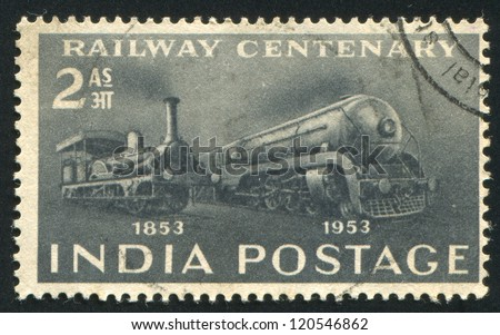 INDIA - CIRCA 1953: stamp printed by India, shows First Locomotive and Streamliner, circa 1953 - stock photo