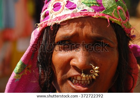 INDIA, COLVA - NOVEMBER 27, 2007: Street portrait of an unidentified Indian woman in the street with a ring in her nose in the state of Goa - stock photo