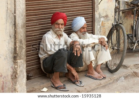 India, Delhi. 30 April 2005. Two elderly hindus with traditional turbans - stock photo