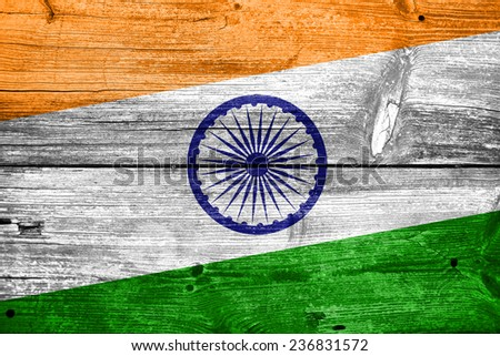India Flag painted on old wood plank texture - stock photo