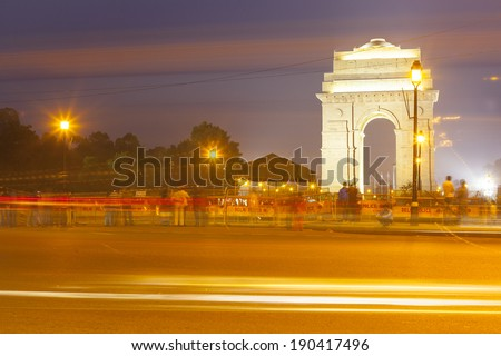 India Gate at night and traffic - stock photo
