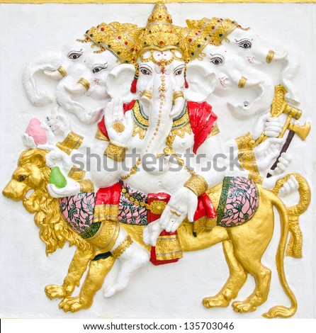 India God Ganesha or God of success  image in stucco low relief technique at Wat Samarn temple,Chachoengsao,Thailand.This is traditional and generic style in Thailand. No any trademark in this photo. - stock photo