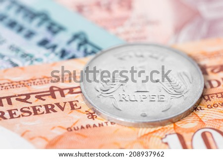 India money banknote focus on coin rupee - stock photo