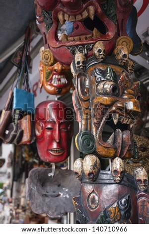 INDIA, Rajasthan, Jaipur, indian wooden masks for sale in a local store