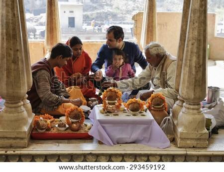 India, Rajasthan, Jaipur; 25 january 2007, indian family in a hindu temple near Sisodia Rani Ka Bagh Palace - EDITORIAL - stock photo