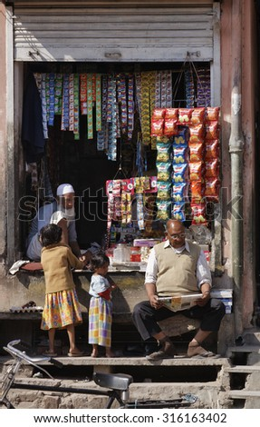 India, Rajasthan, Jaipur; 26 January 2007, indian people at a local store - EDITORIAL - stock photo