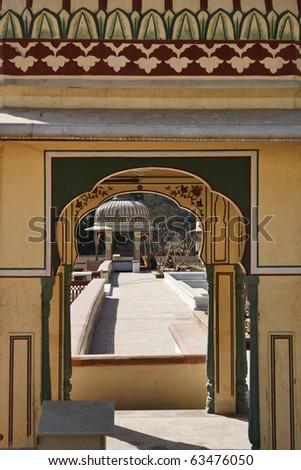 India, Rajasthan, Jaipur, Sisodia Rani Ka Bagh Palace, built in 1710 A.D. by Maharaja Sawai Jai Singh, indian women in the garden - stock photo