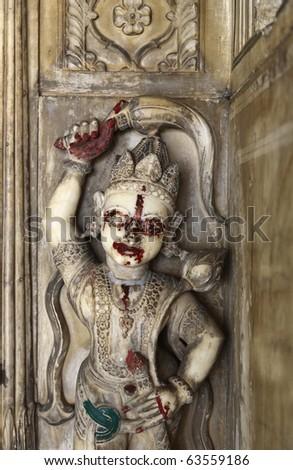 India, Rajasthan, Jaipur, Sisodia Rani Ka Bagh Palace, built in 1710 A.D. by Maharaja Sawai Jai Singh, religious statue - stock photo