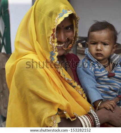 India, Rajasthan, Pushkar, indian woman with her baby - stock photo