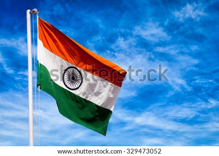 India symbol indian flag against blue sky - stock photo