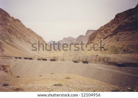 Indian army trucks in remote Kashmir region. - stock photo