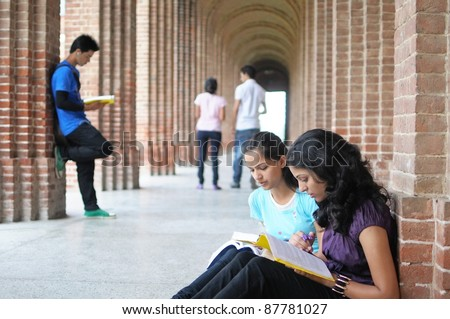 Indian / Asian College students preparing for examination. - stock photo