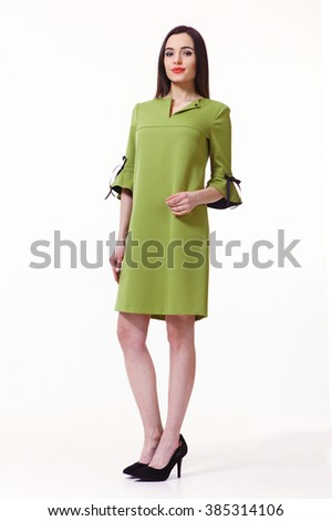 indian asian eastern brunette business executive woman with straight hair style in pistachio summer dress high heels shoes full length body portrait standing isolated on white - stock photo