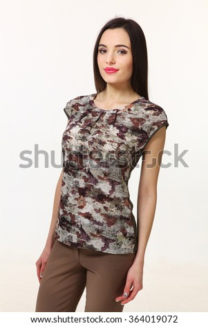 indian asian eastern brunette business executive woman with straight hair style in printed khaki blouse t-shirt and trousers close up portrait isolated on white - stock photo