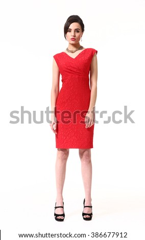 indian asian eastern brunette business executive woman with straight hair style in red sleeveless formal dress high heel shoes standing full body length isolated on white - stock photo