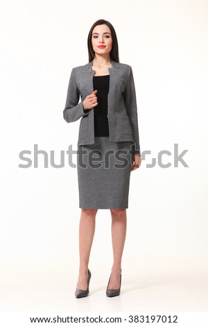 indian asian eastern brunette business executive woman with straight hair style in two pieces jacket and skirt suit   high heels shoes full length body portrait standing isolated on white - stock photo