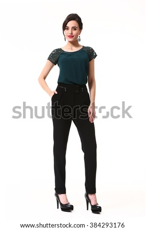 indian asian eastern brunette business executive woman with up do hair style in dark green tshirt and black trousers  high heels shoes full length body portrait standing isolated on white - stock photo