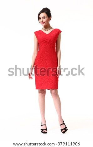indian asian eastern brunette business executive woman with updo hair style in official sleeveless red cocktail party dress high heels sandals shoes stand full body length isolated on white - stock photo