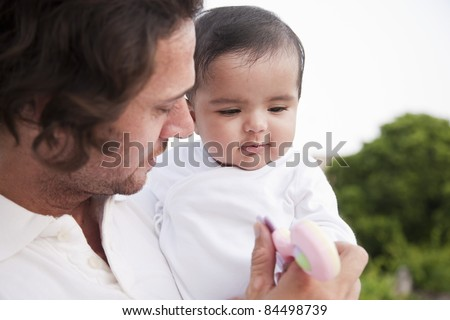 Indian baby girl and a caucasian father, biracial ethnic family. - stock photo
