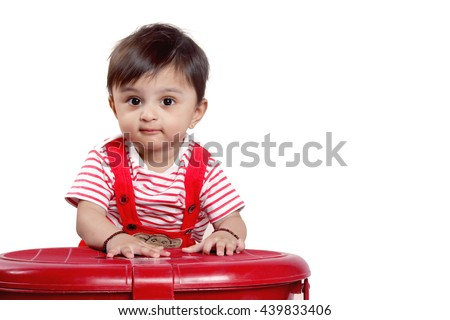 Indian Baby on red tshart - stock photo