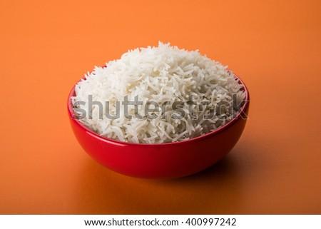 indian basmati rice, pakistani basmati rice, asian basmati rice, cooked basmati rice, cooked white rice, cooked plain rice in ceramic bowl  over colourful background - stock photo